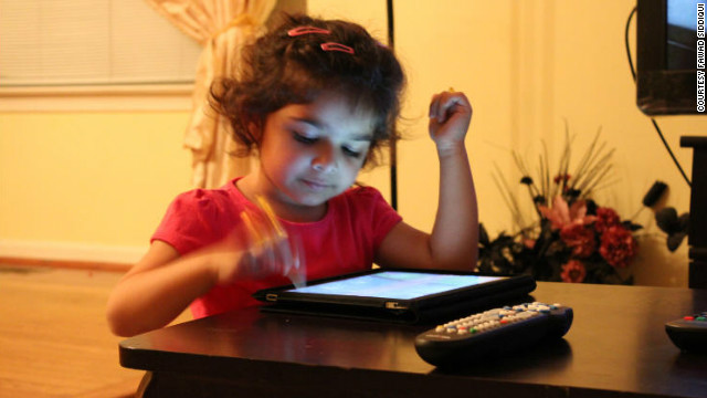 "Sharia Siddiqui uses an iPad to help her communicate. Her father says it's ""given her a sense of control she never had."""