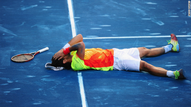 Fernando Verdasco celebrates after ending Rafael Nadal's 22-match clay winning run at the Madrid Open.