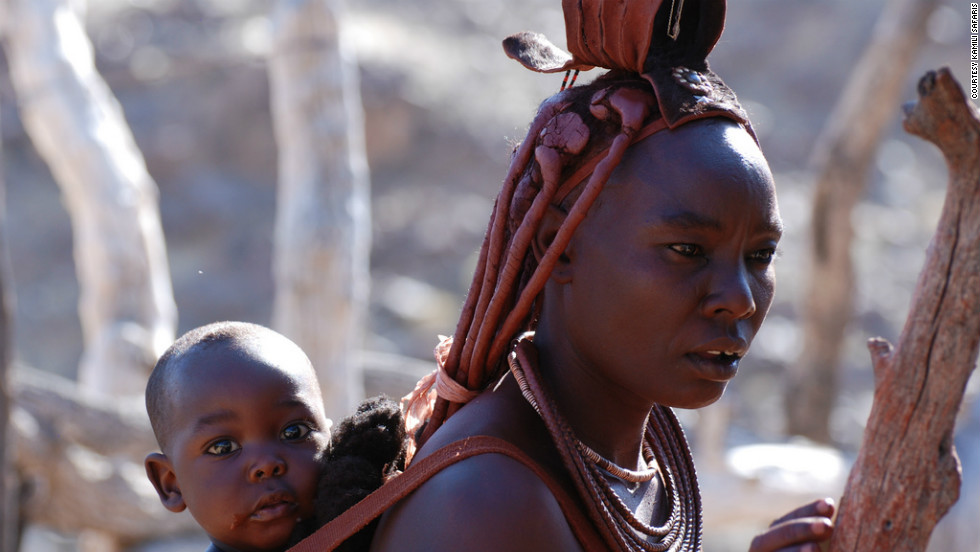 Himba children stay with their mother until the age of three, when they live with their siblings and are cared for by all members of the village.