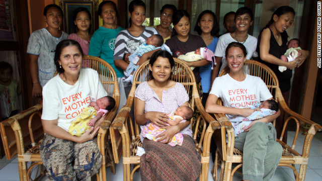 Christy Turlington Burns, seated right, and CNN Hero Robin Lim, seated left, with moms and their newborns at the Bumi Sehat clinic in Bali, Indonesia