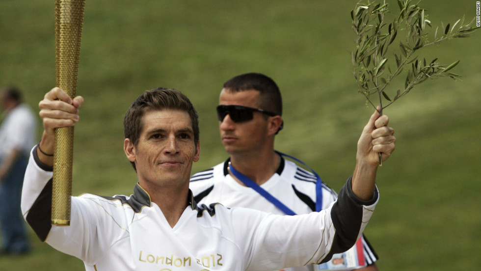 More than 8,000 torch-bearers will carry the flame before it arrives at the Olympic Stadium in east London on July 27. The first was Greek swimming champion Spyros Gianniotis.
