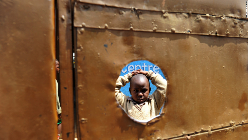 According to the WHO, every 90 seconds a woman dies from a pregnancy-related complication somewhere in the world leaving children to grow up with out their mother. Here five-year-old Peter Otieno stands in the inside courtyard of the preschool he attends in Kenya. Peter is HIV positive and became infected after his mother gave birth to him. Both his father and his mother have passed away.
