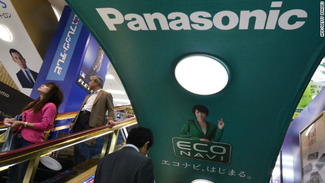 People ride an escalator past a Panasonic advertisement in Tokyo.