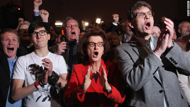 Supporters of the Social Democrats cheer initial exit poll results on Sunday in Dusseldorf, Germany.