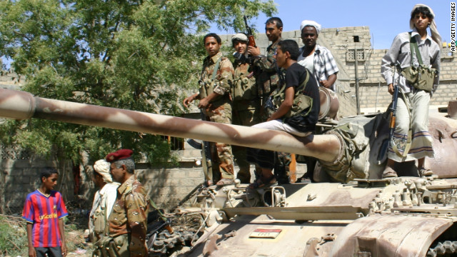 Yemeni troops gather atop an army tank during a lull in fighting against suspected al Qaeda militants on May 6.