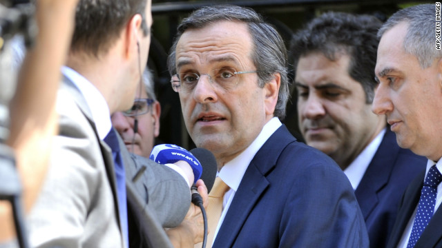The leader of the conservative New Democracy party, Antonis Samaras, leaves the presidential palace in Athens Sunday after a meeting with Greek President Carolos Papoulias.