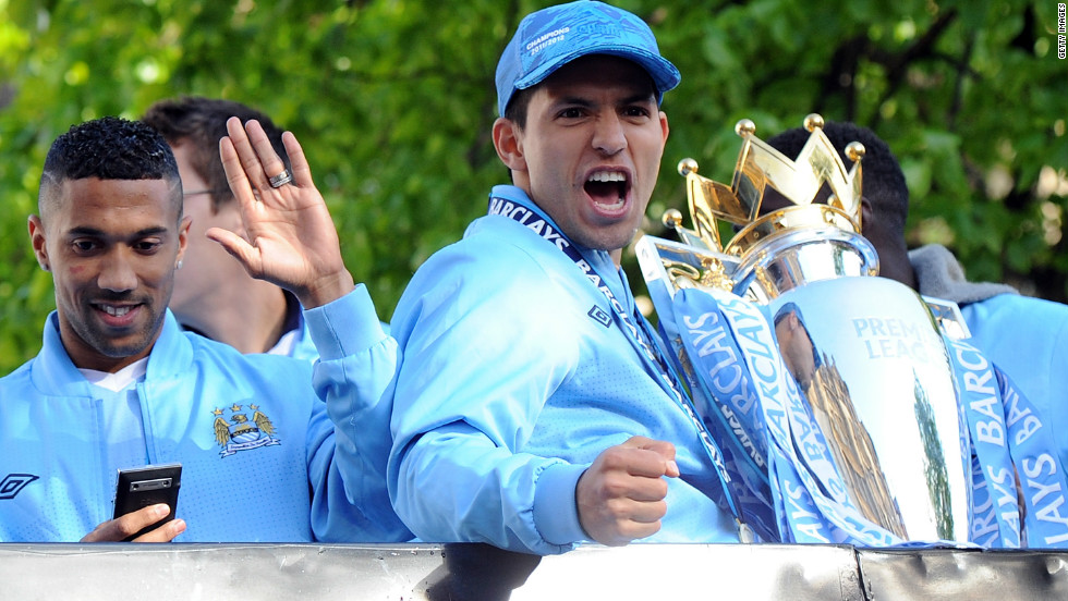 Sergio Aguero, the scorer of the late goal which clinched the EPL title for Manchester City, acknowledges the City fans during the parade.