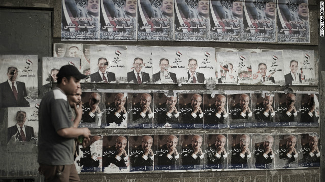 Posters for presidential candidates hang in Cairo on April 30, 2012.