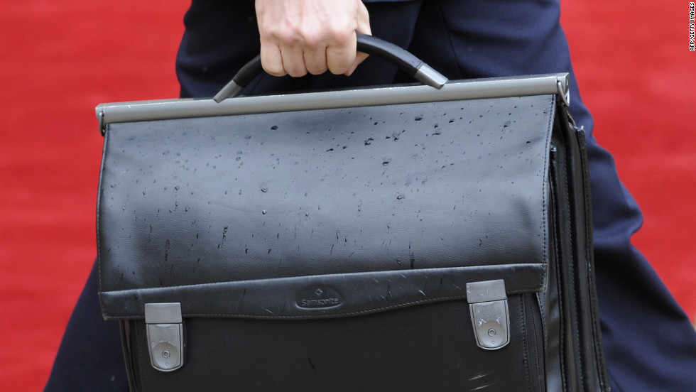 The French president's nuclear satchel is carried through the Élysée Palace.
