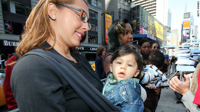 Mothers and babies attend a rally in New York. The writers say that another faux mommy war is on the horizon.