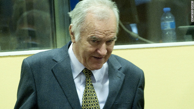 Former Bosnian Serb army chief Ratko Mladic (R) arrives on May 16, 2012 at the International Criminal Tribunal for the former Yugoslavia (ICTY) in The Hague before the opening of his war crimes trial.