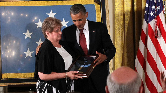 President Barack Obama presents the Medal of Honor to Rose Mary Sabo-Brown.