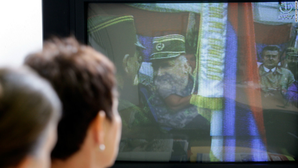 Bosnian Muslim women who survived the Srebrenica massacre, Sabra Kolenovic, right, and Sabaheta Fejzic watch the news of Mladic's arrest in Sarajevo on May 26, 2011.