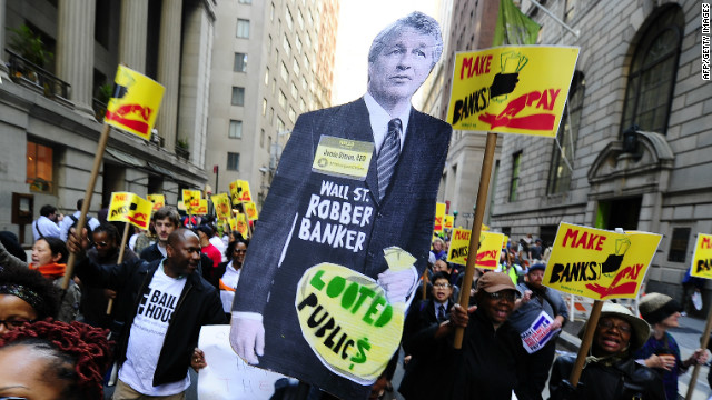 A cutout figure of JPMorgan Chase CEO Jamie Dimon hovers above a May 2011 protest against banks on Wall Street.