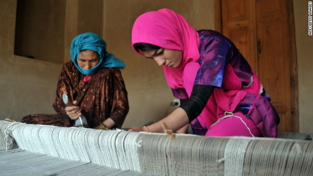 Afghan weavers work in the old city area of Kabul on May 10.