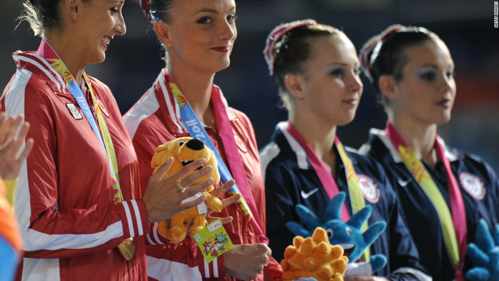 Killman and Koroleva (right) on the podium of the 2011 Pan American Games, where they won the silver medal behind the Canadian pair in the duet competition.