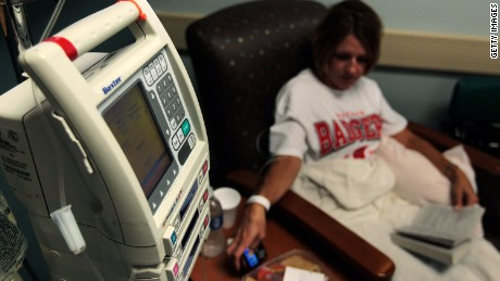 Cancer patient Kimberly Paulson sits with a book as she gets her chemotherapy treatment at the Cape Fear Valley Cancer Center August 4, 2010 in Fayetteville, North Carolina.