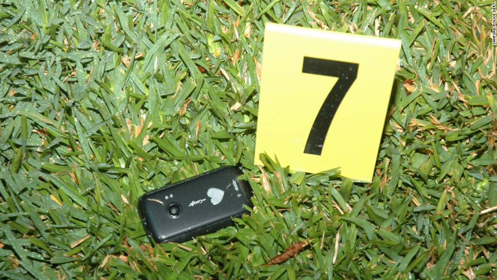 Crime scene photos released by the Sanford Police Department show Trayvon Martin's cell phone at the scene of the shooting.