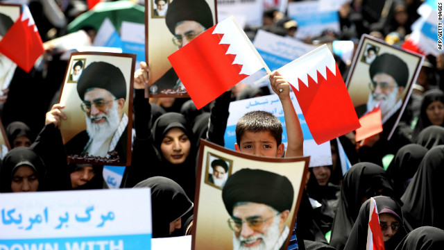 Iranian demonstrators wave Bahraini flags during a protest after the Friday noon prayer in Tehran on May 18, 2012.