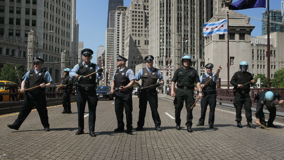 Officers form a line to prevent protesters from crossing the Michigan Avenue Bridge during protests on Friday.