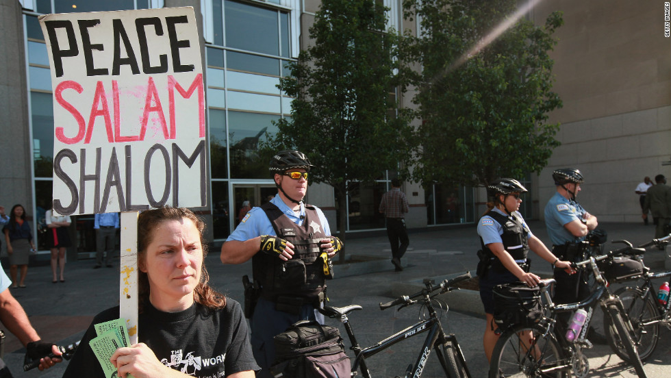 Police guard President Barack Obama's national campaign headquarters in the Prudential Building in Chicago during protests on Monday, May 14.