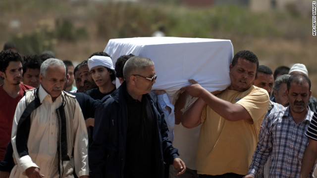 The coffin containing the body of Abdelbaset Ali Mohmet al-Megrahi is carried during his funeral in Janzur, Libya.