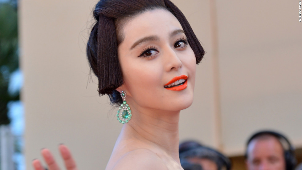 Chinese model Fan Bingbing waves from the red carpet ahead of the opening ceremony on May 16.
