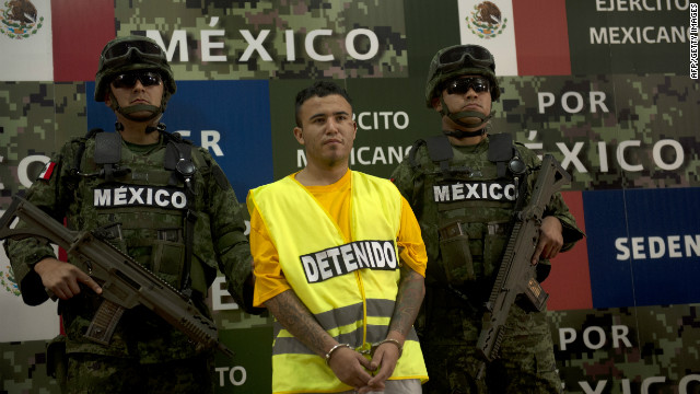 "Mexican soldiers escort suspect Daniel de Jesus Elizondo Ramirez, known as ""El Loco."""