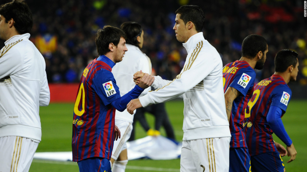 Barcelona's Lionel Messi (left) and Real Madrid's Cristiano Ronaldo (right) -- widely considered the two best players in the world -- shake hands before the 'El Classico' derby between Spain's two biggest clubs. But is the huge wealth of Barca and Real damaging the rest of Spanish football?