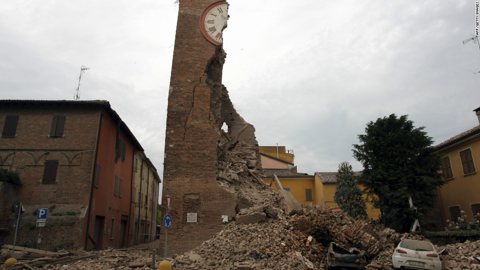 The tower crumpled to ground after the quake, destroying the cars parked below it as it flooded the street with bricks.