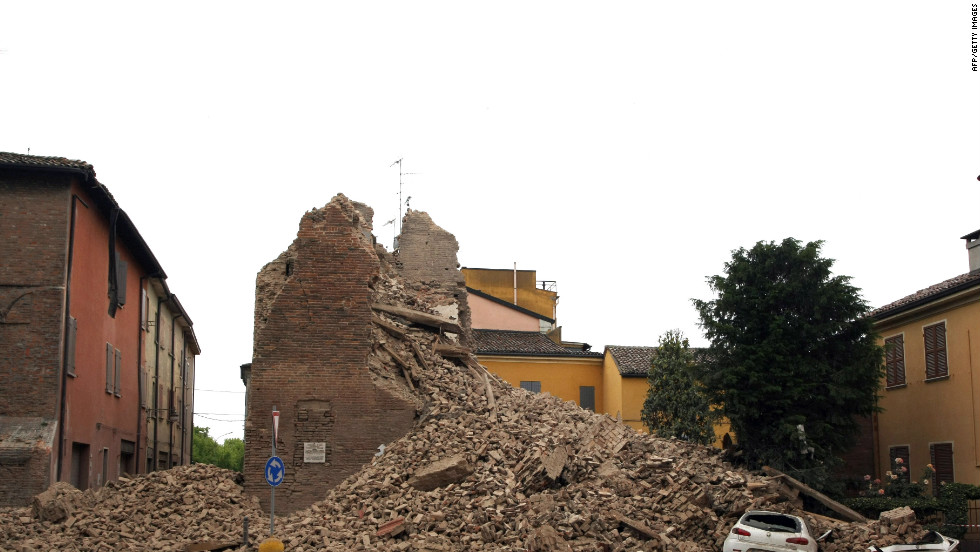 Rubble from the clock tower buries a car under its bricks.
