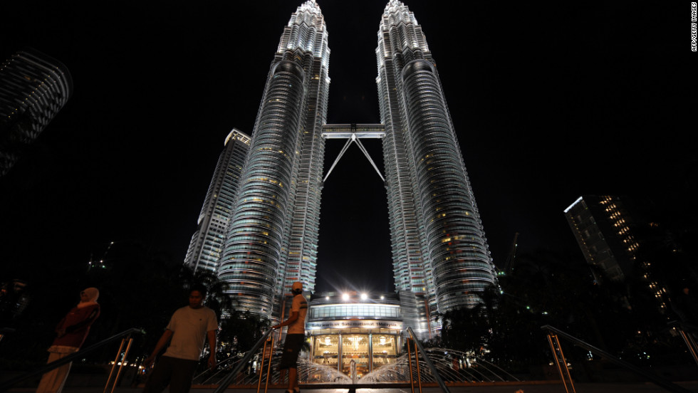 Completed in 1998, the twin Petronas Towers in Kuala Lumpur each have an architectural height of 1,483 feet (451.9 meters) and are each occupied to a height of 1,230 feet (375 meters). The two towers are tied for the sixth tallest skyscrapers in the world.