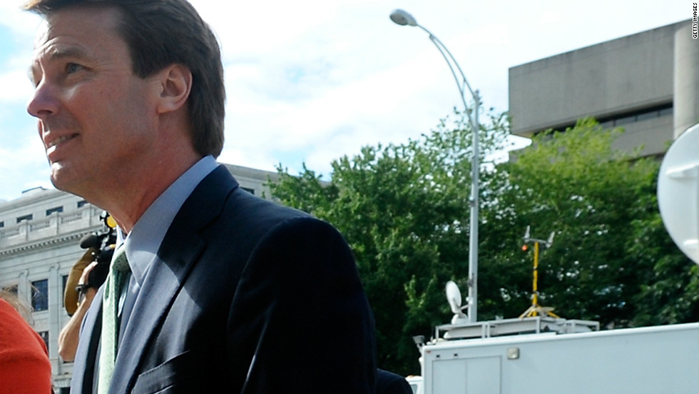Edwards enters a Greensboro, North Carolina, courthouse for his federal corruption trial with daughter Cate on May 21, 2012.
