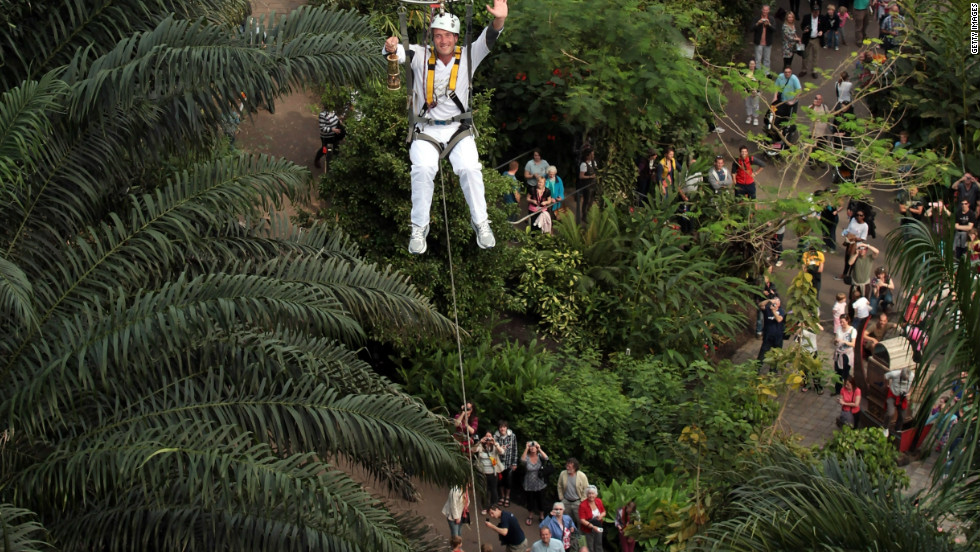Television presenter Ben Fogle made a dramatic entrance as he carried the flame in a hot air balloon inside the rainforest biome -- known as the Eden Project -- in Cornwall, on day two of the relay.