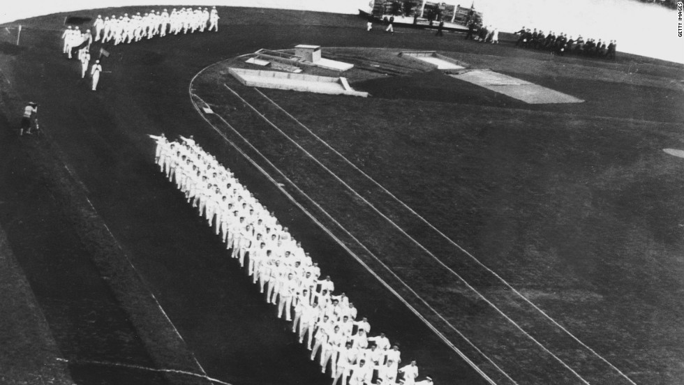 The Olympic flame originated in ancient Greece, where a fire was kept burning throughout the Games. The tradition was reintroduced at the 1928 Amsterdam Olympics, pictured here during the opening ceremony.