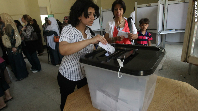 An Egyptian woman casts her ballot in Cairo on May 23 in the country's first free presidential election.