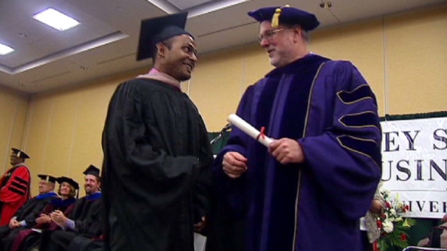 Arson survivor graduates with MBA