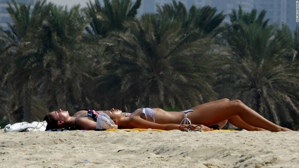 The expectation for foreign women is more relaxed, and it is acceptable for them to wear bikinis on beaches, such as at Dubai Marina.