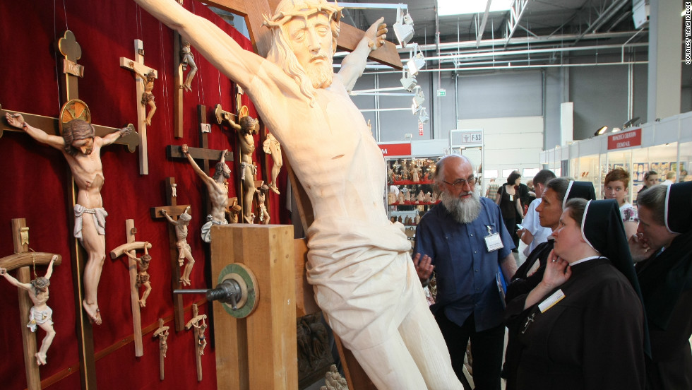 Crucifixes large and small are available for churches in Europe's biggest fair devoted to sacral art.