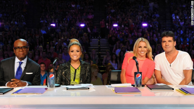"L.A. Reid (far left), Demi Lovato, Britney Spears and Simon Cowell during a taping of ""The X Factor."""