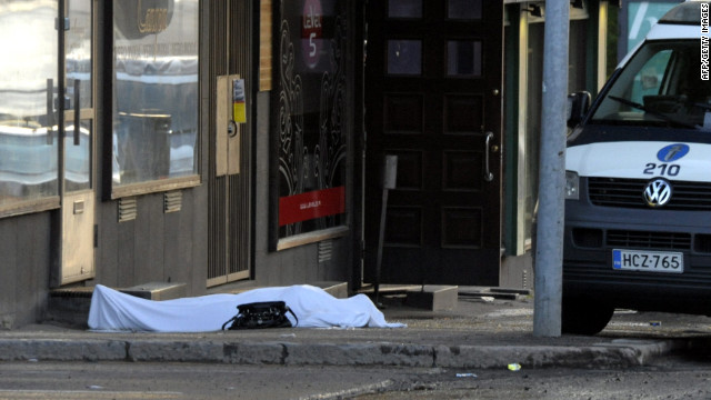 The body of a shooting victim lies on the ground where a gunman opened fire in Hyvinkaa, Finland, on Saturday.