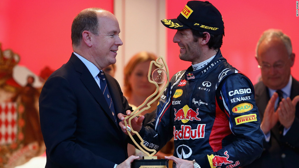 Mark Webber receives the winning trophy from Prince Albert II of Monaco after his superb victory from pole.