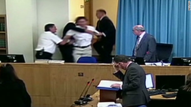 Protester disrupts Blair testimony