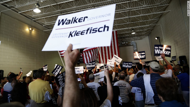 Supporters cheer for Republican Wisconsin Gov. Scott Walker as he campaigns ahead of the June 5 recall election.