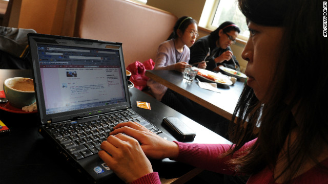 A woman views the Chinese social media website Weibo at a cafe in Beijing in April.