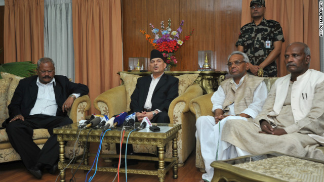 Nepalese Prime Minister Baburam Bhattara, second from left, speaks during a press conference in Kathmandu on May 27, 2012.
