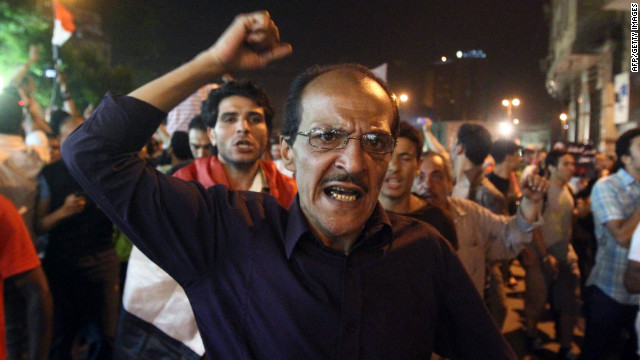 An Egyptian man shouts slogans during a demonstration Monday after the first round of elections in Cairo.