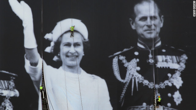 A giant photograph of Queen Elizabeth II and The Duke of Edinburgh is erected on a building on The River Thames on May 25.