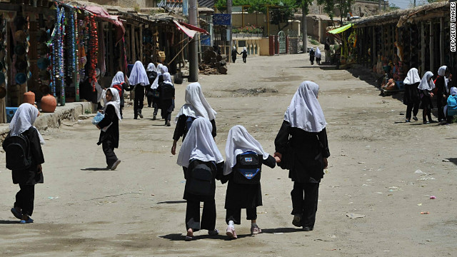 Afghan girls walk to school Tuesday in the village of Istalif, about 30 kilometers north of Kabul.