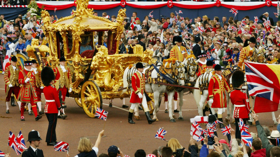 Queen Elizabeth and Prince Philip ride in the Golden State Carriage during a parade to celebrate the queen's Golden Jubilee in 2002. They are expected to ride in a similar carriage for the Diamond Jubilee procession on Tuesday 5 June.